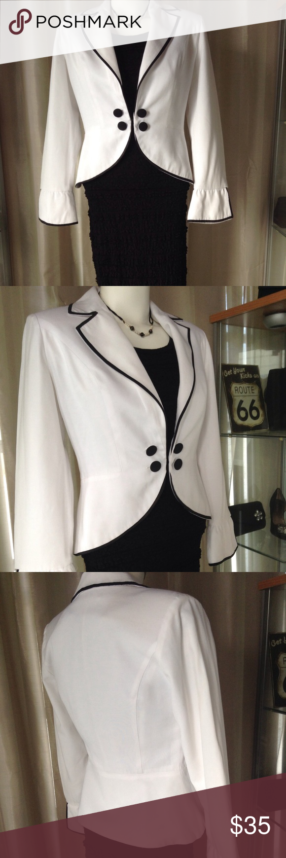 VINTAGE WHITE PEPLUM JACKET WITH BLACK TRIM This is a basic but chic piece of vintage fashion. The jacket has 4 tuxedo type buttons as embellishments & a small hook closure & yes it does has small shoulder pads!  I love this over a simple black sheath dress to take you to an event as a light, figure flattering & stylish cover up! I find its best to avoid styling white with white due to the various shades. I added a simple vintage short necklace with white & black glass beads with enamel…