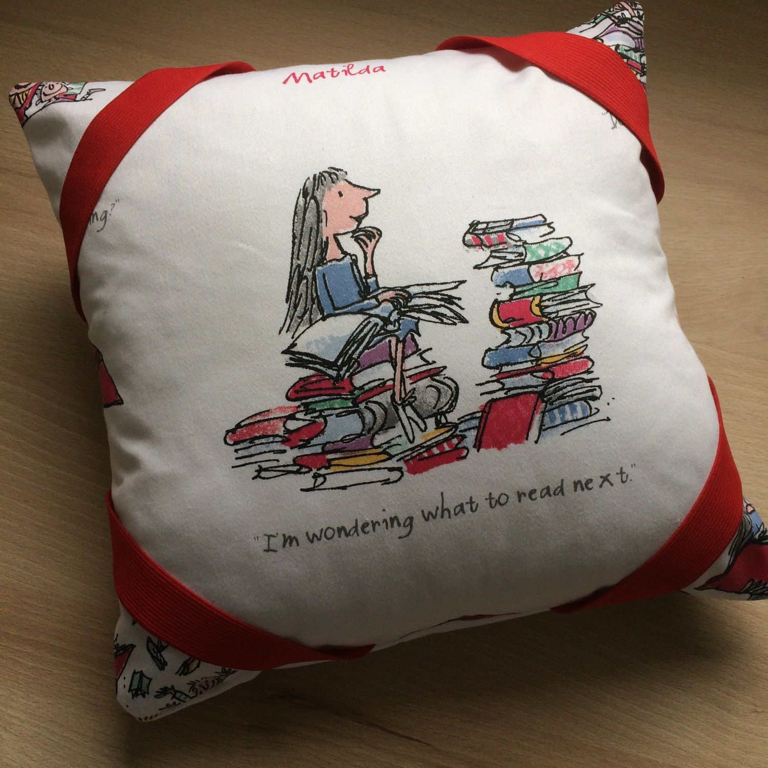 Roald Dahl book cushions with elasticated corners to hold Book in place and a large storage pocket to the back.
