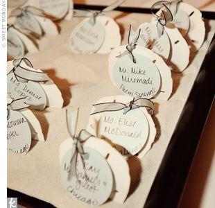 For their DIY escort cards, Lauren bought dark wood serving trays ...