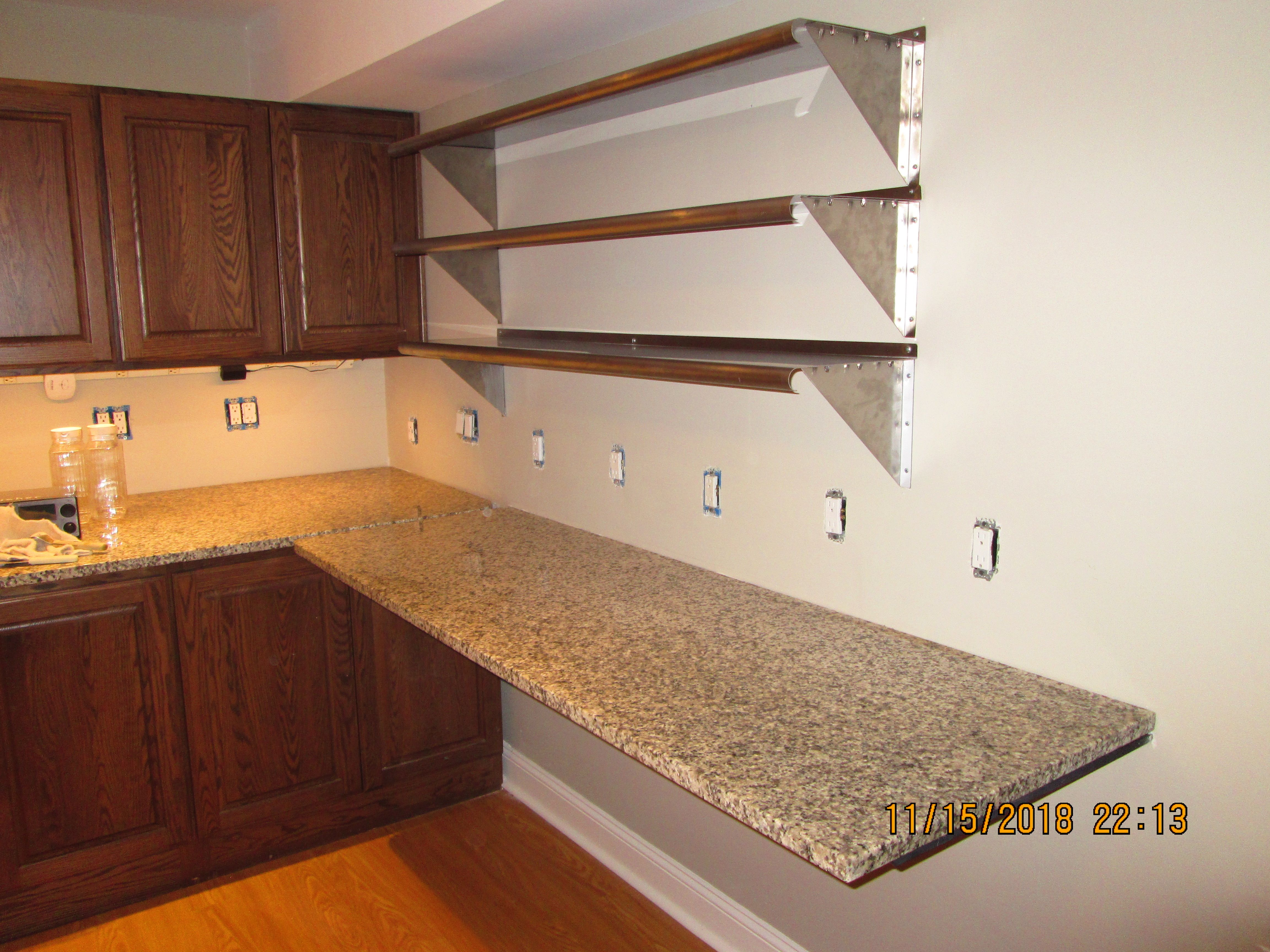 Kitchenette With 25 By 76 Wall Hung Granite Countertop Heavy