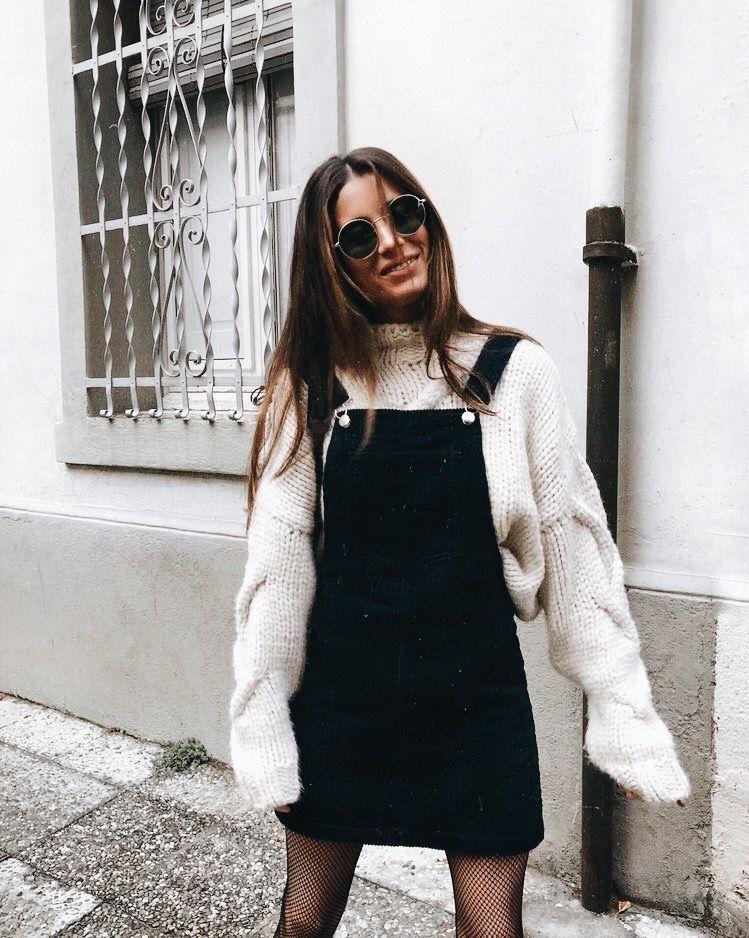 white sweater, black skirt overalls, black fishnet tights, black sunglasses  · Fishnet TightsWinter Layering OutfitsWinter