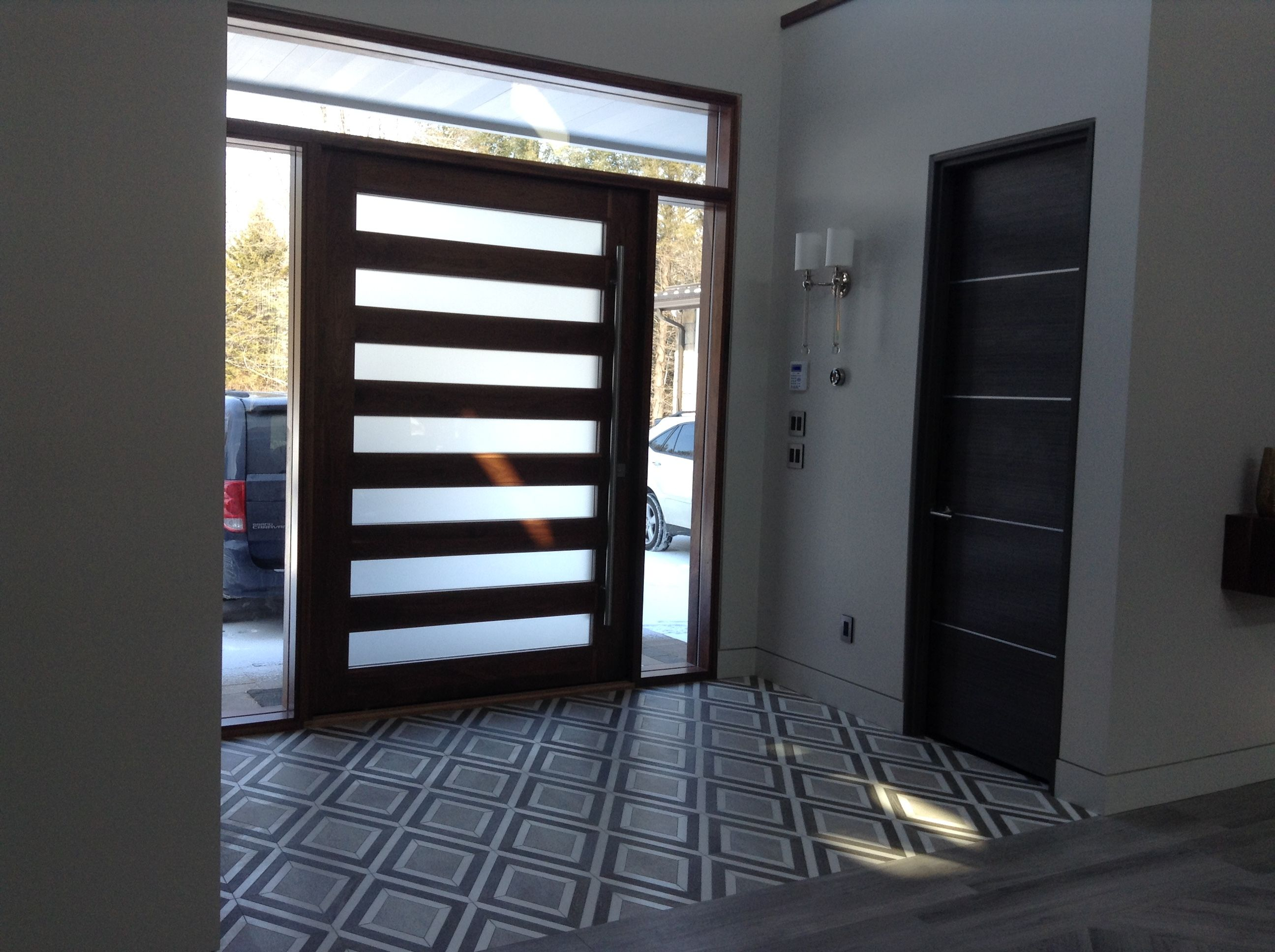 Walnut Pivot Entry Door Foyer Diamond Floor Tile Modern Horizontal