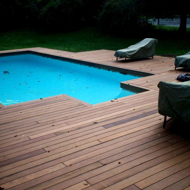 The Ultimate Backyard Amenity Just Got Better Get Rid Of Your Old Concrete Surrounding The Pool It Just Cracks And Wood Pool Deck Wooden Pool Deck Pool Decks