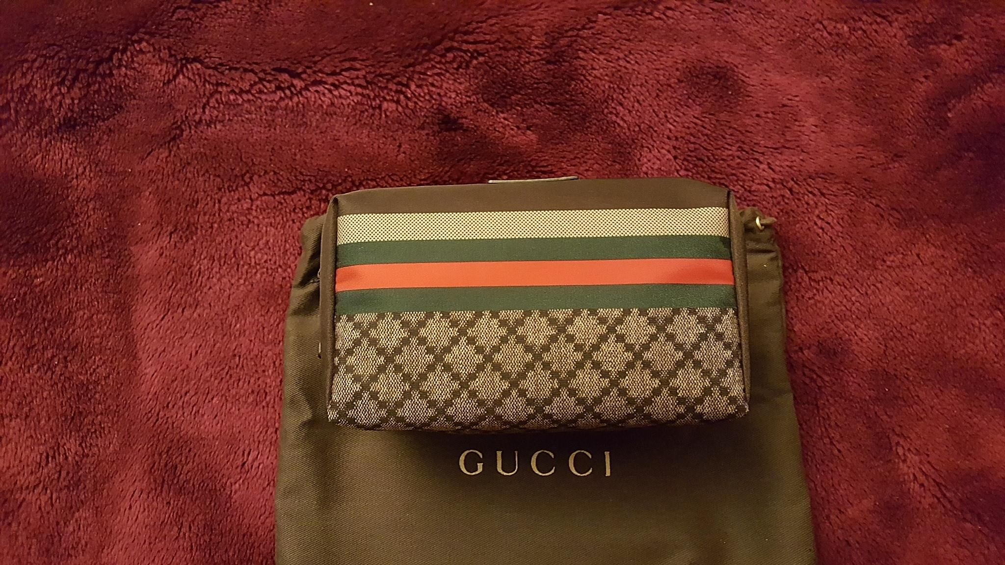 a77f5a05214 Get the trendiest Clutch of the season! The Gucci Web Gg Logo Cosmetic  Travel Makeup Multi Clutch is a top 10 member favorite on Tradesy.