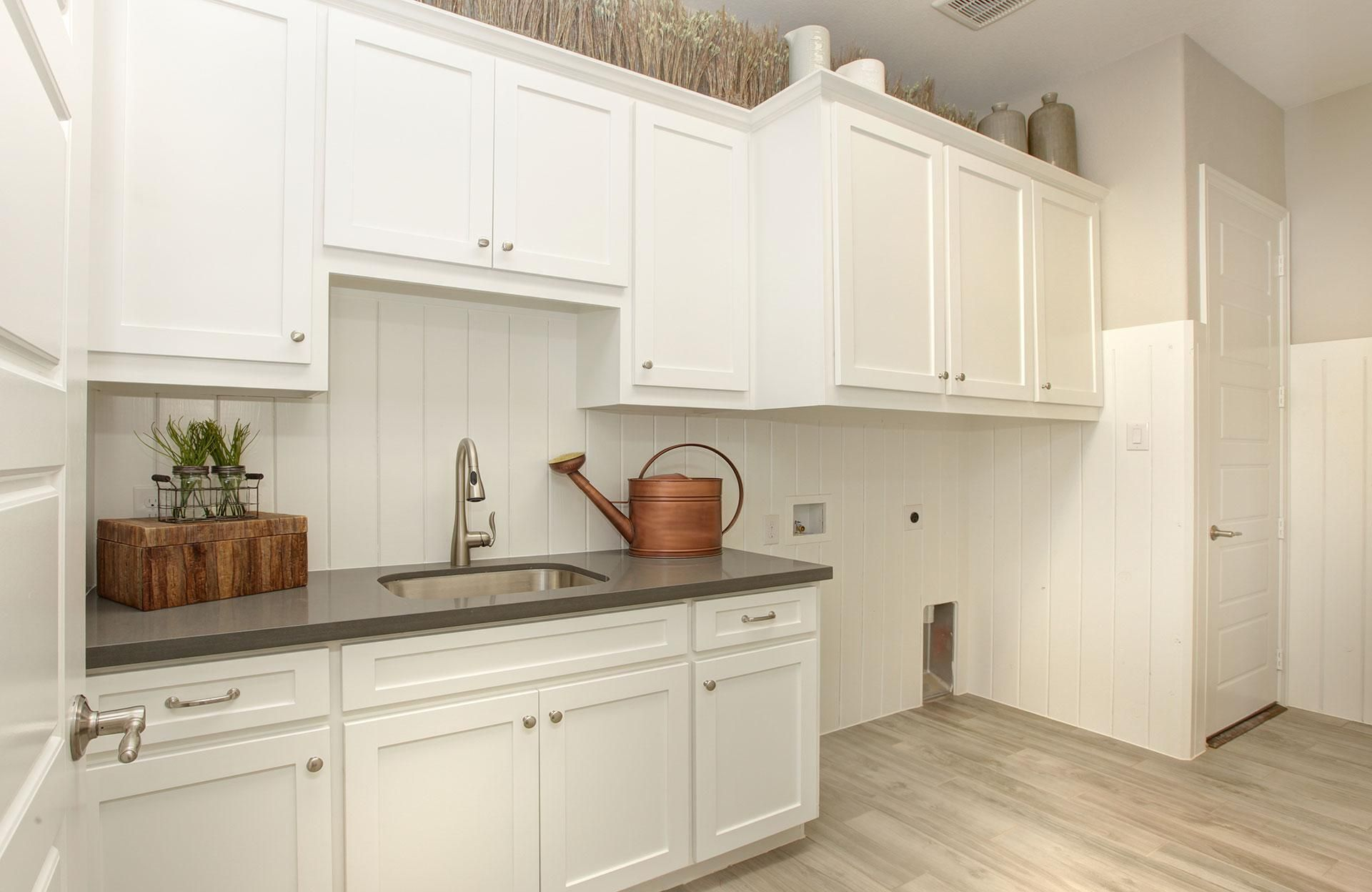 Kitchen with large serving island; The Buchanan floor plan, Drees ...