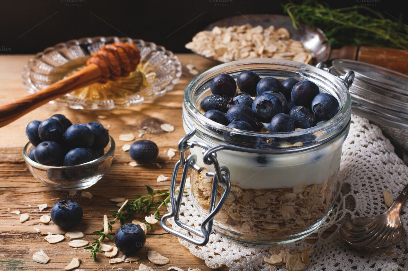 Muesli with yogurt and blue berries in glass jar. by Iryna Melnyk Photography on @creativemarket