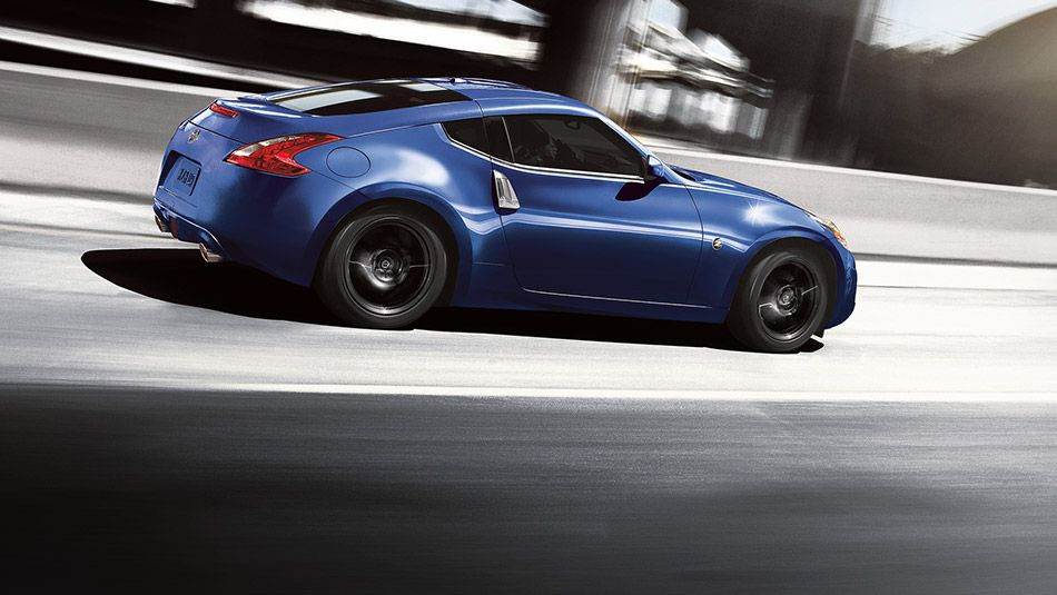 nissan 350z 2016. 2016 nissan coupe touring in midnight blue side view driving on street 350z
