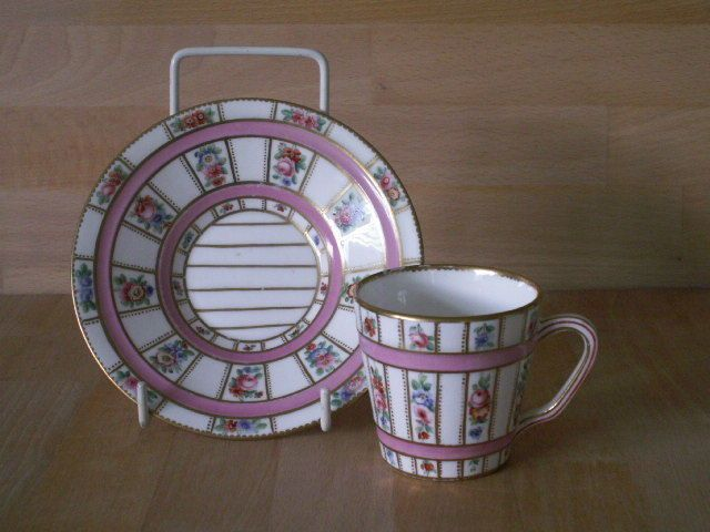 MINTON HAND PAINTED FLORAL BARREL STYLE CUP AND SAUCER WITH PINK ENAMEL BANDS