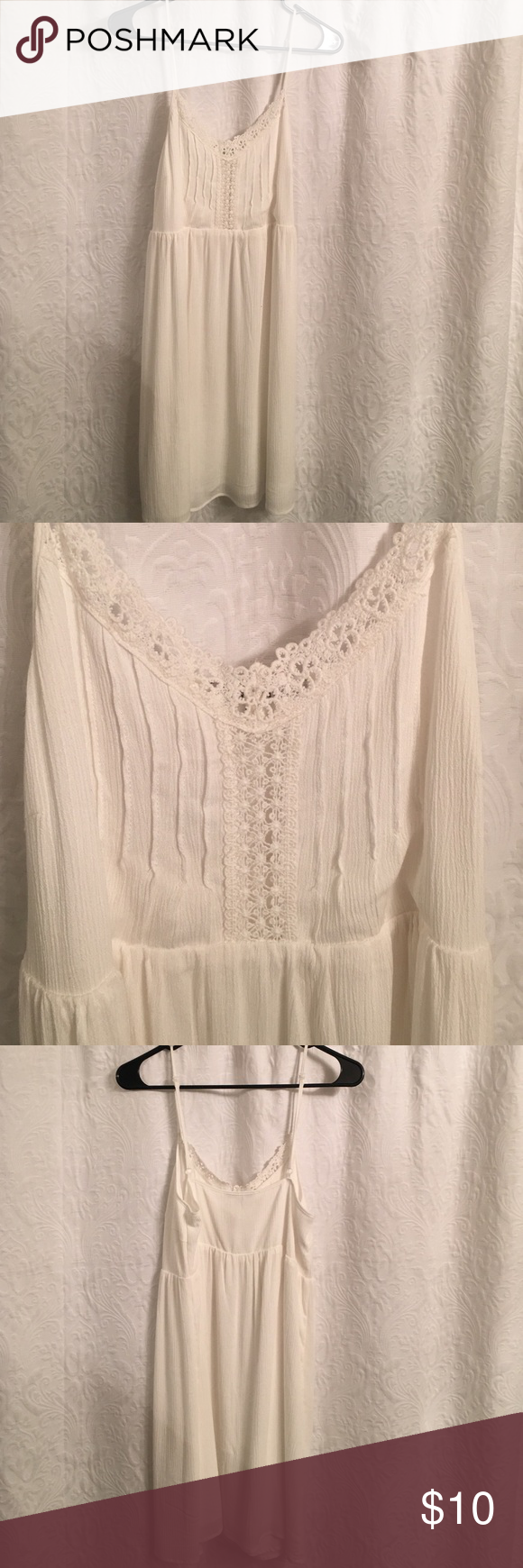 Baby doll dress White babydoll style spaghetti strap dress! 100% rayon. Size medium. Super cute. Never been worn. Not free people. Free People Dresses Mini