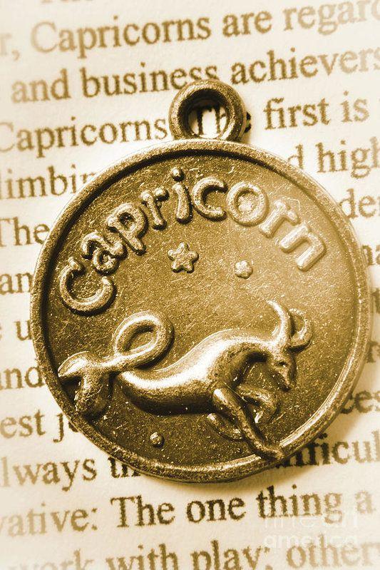 Bronze capricorn astrology medallion pendant close-up. Capricorn zodiac lucky charm by Jorgo Photography - Wall Art Gallery
