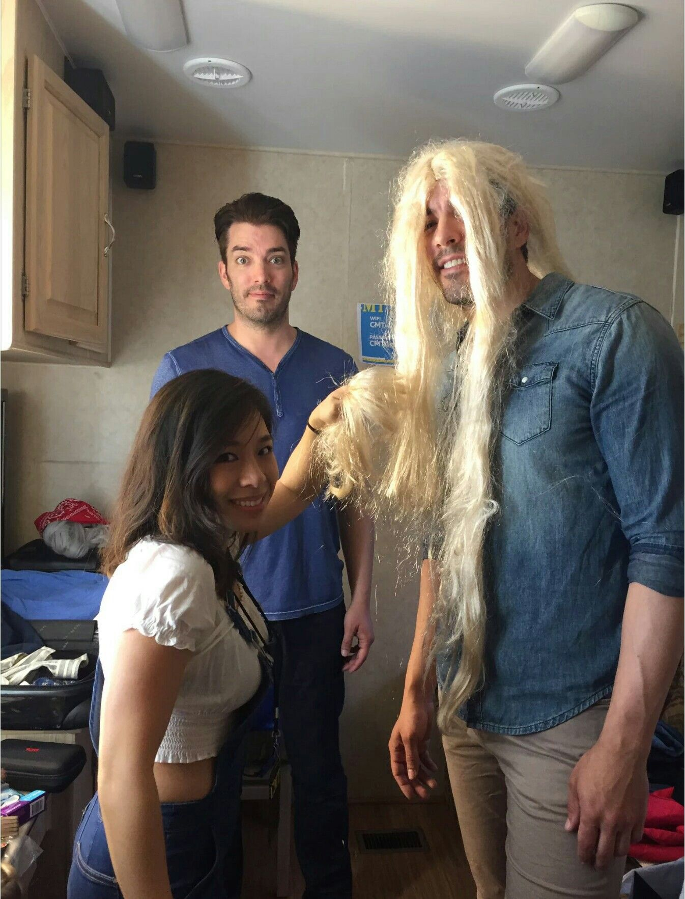 the scott brothers, jonathan & drew (in the blonde wig) prepping to