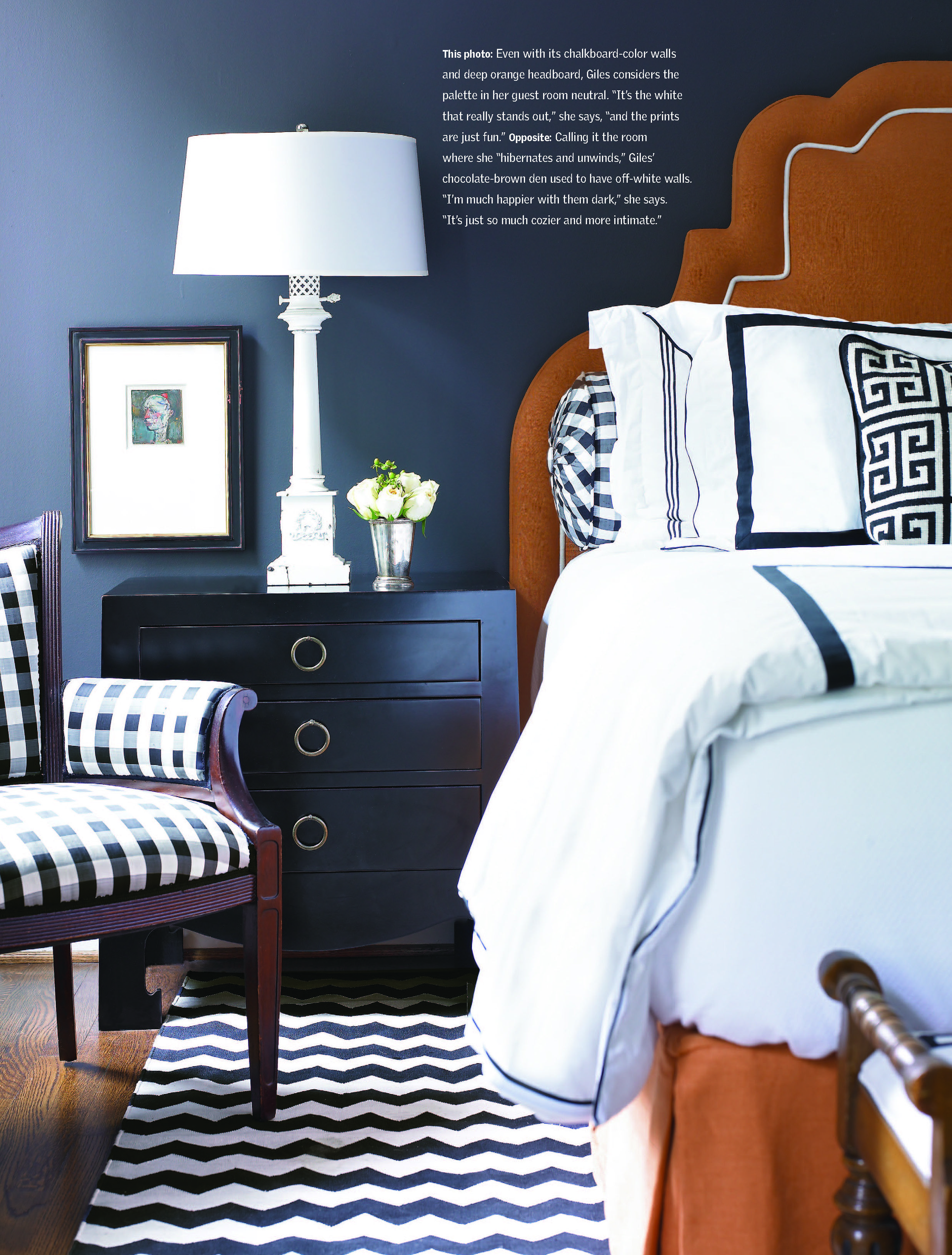 Dark navy paint on the walls works so well with bright white bed