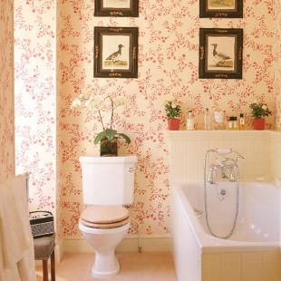 Pretty Red Floral Wallpaper And Framed Vintage Prints For The Bathroom