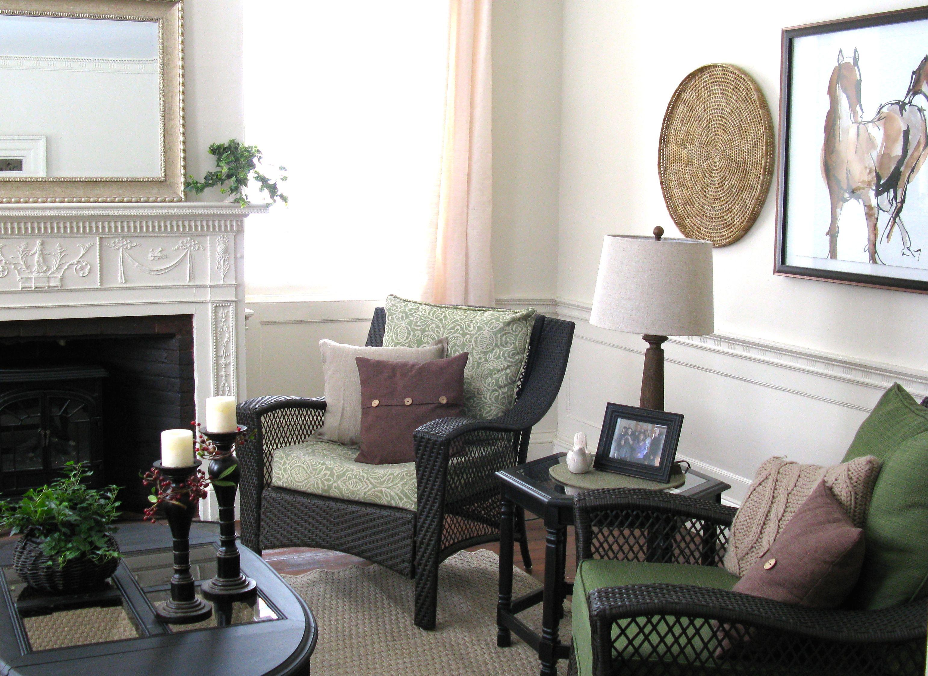 sitting room fireplace wicker furniture green brown black