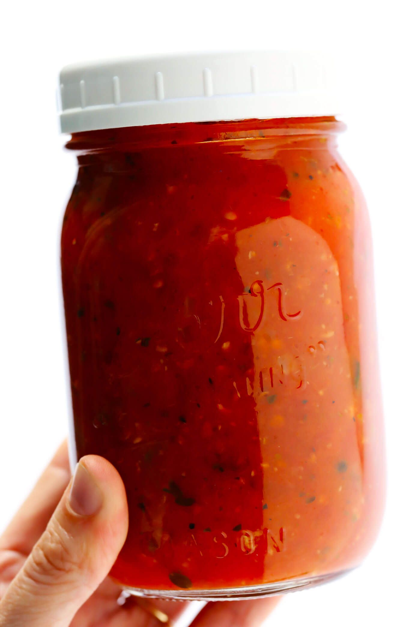 This homemade marinara sauce recipe is easy to make, naturally gluten-free and vegan, and slow-simmered with the BEST tomato, basil and garlicky flavors. Serve it with spaghetti, meatballs, pizza, chicken, mussels, eggplant Parmesan, subs, or whatever sounds good!   gimmesomeoven.com #marinara #sauce #tomato #pasta #glutenfree #vegetarian #vegan #healthy #mealprep #freezermeal #dinner