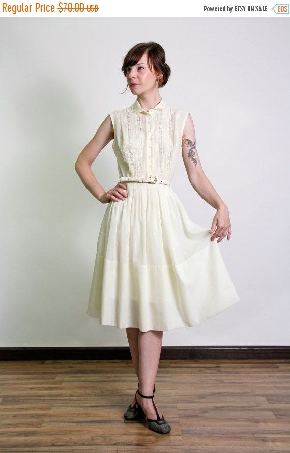 So pretty! Pale yellow frock featuring lace and pin tucks!  circa 1960s no tags, belt not included.  shoulders across top are 15.5 or about 39.5cm arm