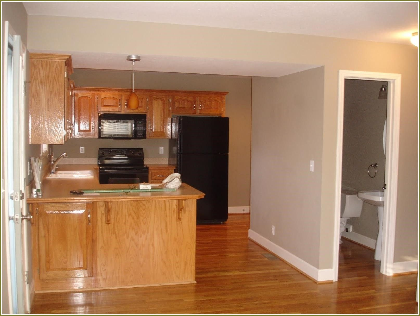 Honey Oak Cabinets With Dark Wood Floors