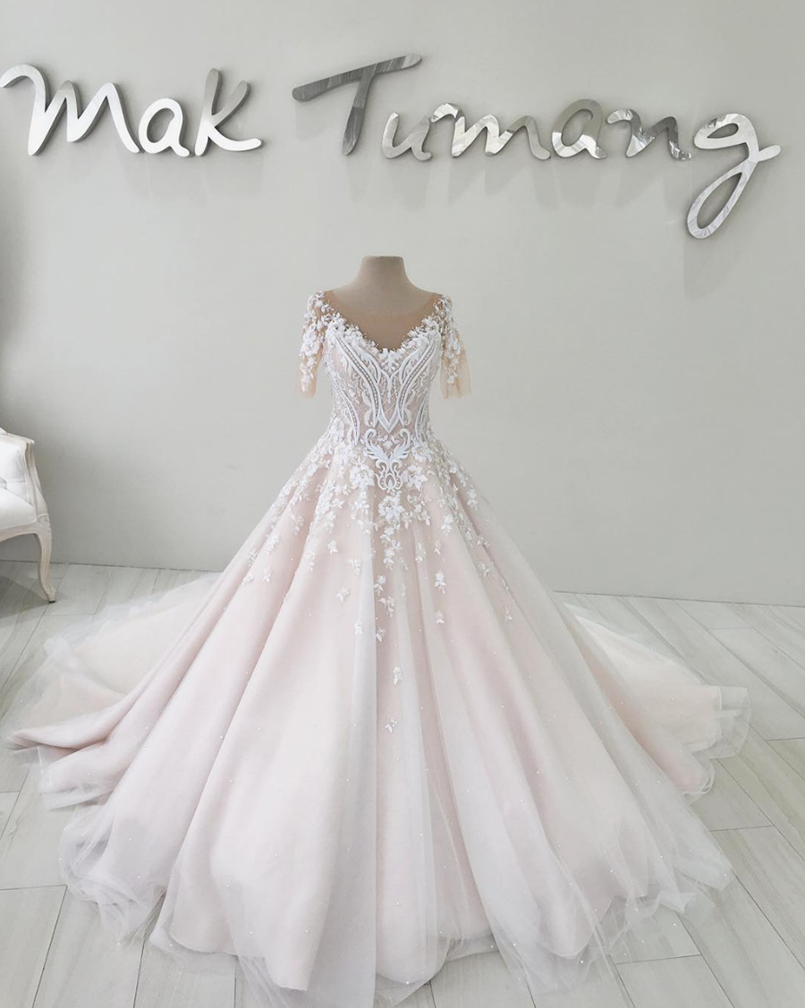 Wedding dress with tulle skirt and illusion sleeves    Filipino designer  Mak Tumang studied interior design before delving into fashion in the  Philippines. b324d7a4aa23