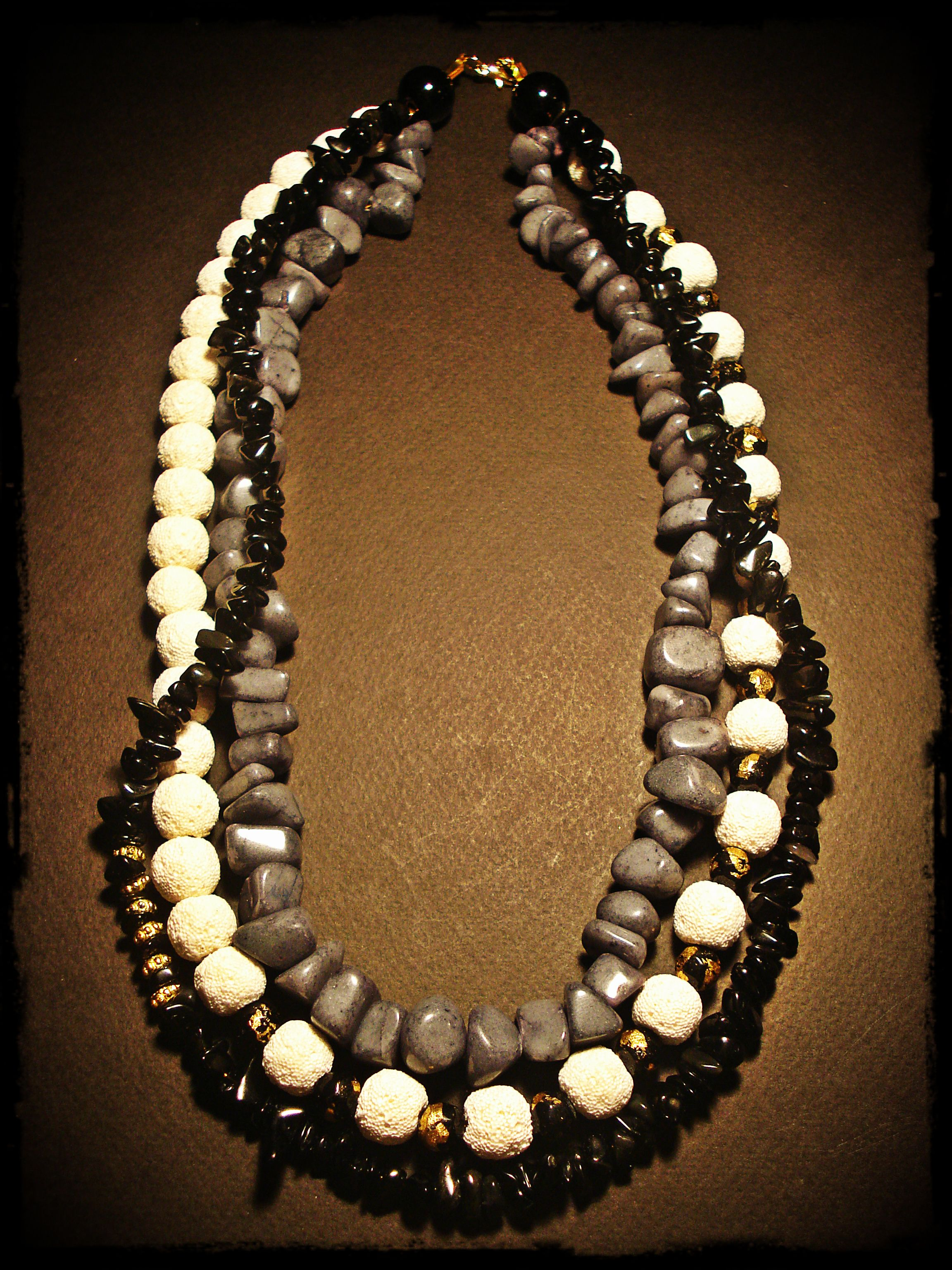 28$, handmade necklace made of grey jade stones, black glass chips and white lava beads