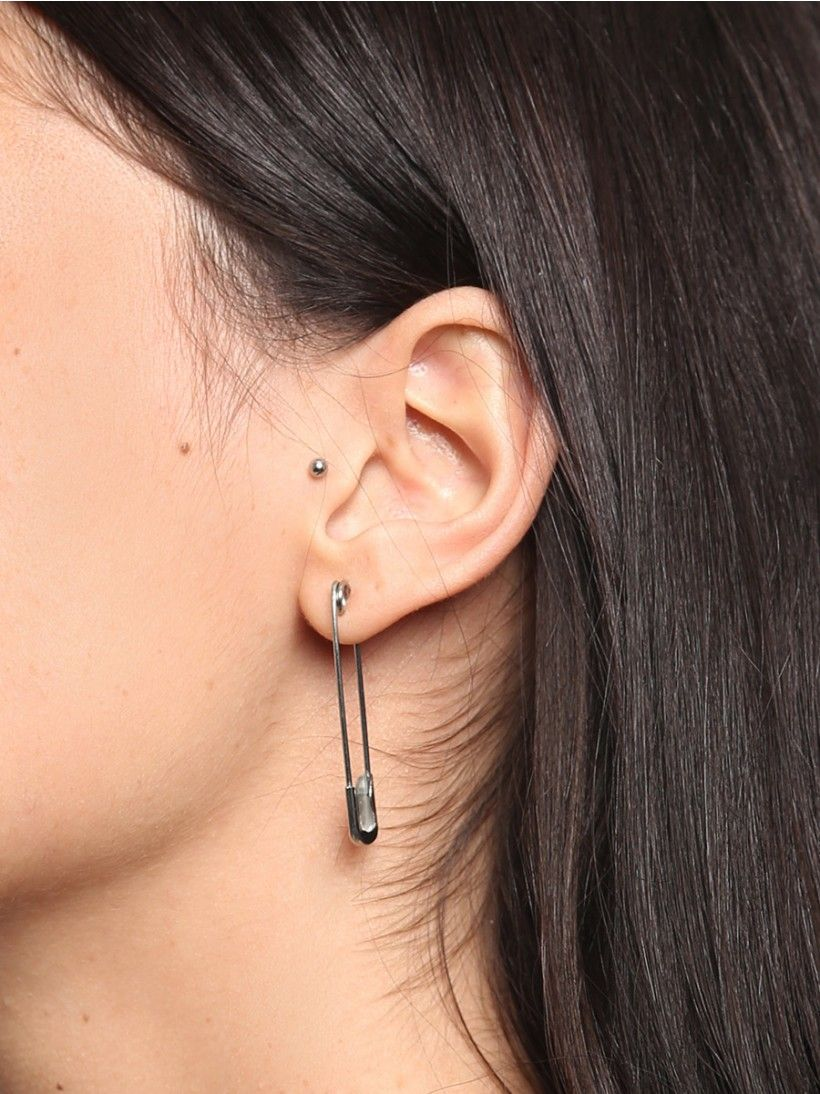 You won't want to play it safe with this awesome safety pin earring. A thin silver tone construction with a matte finish and a push closure. Sold individually.