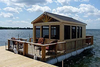Floating cottage houseboat with blue barrels floating for Barrel cabin plans