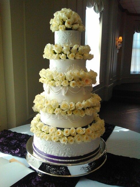 Gorgeous cake with white roses.
