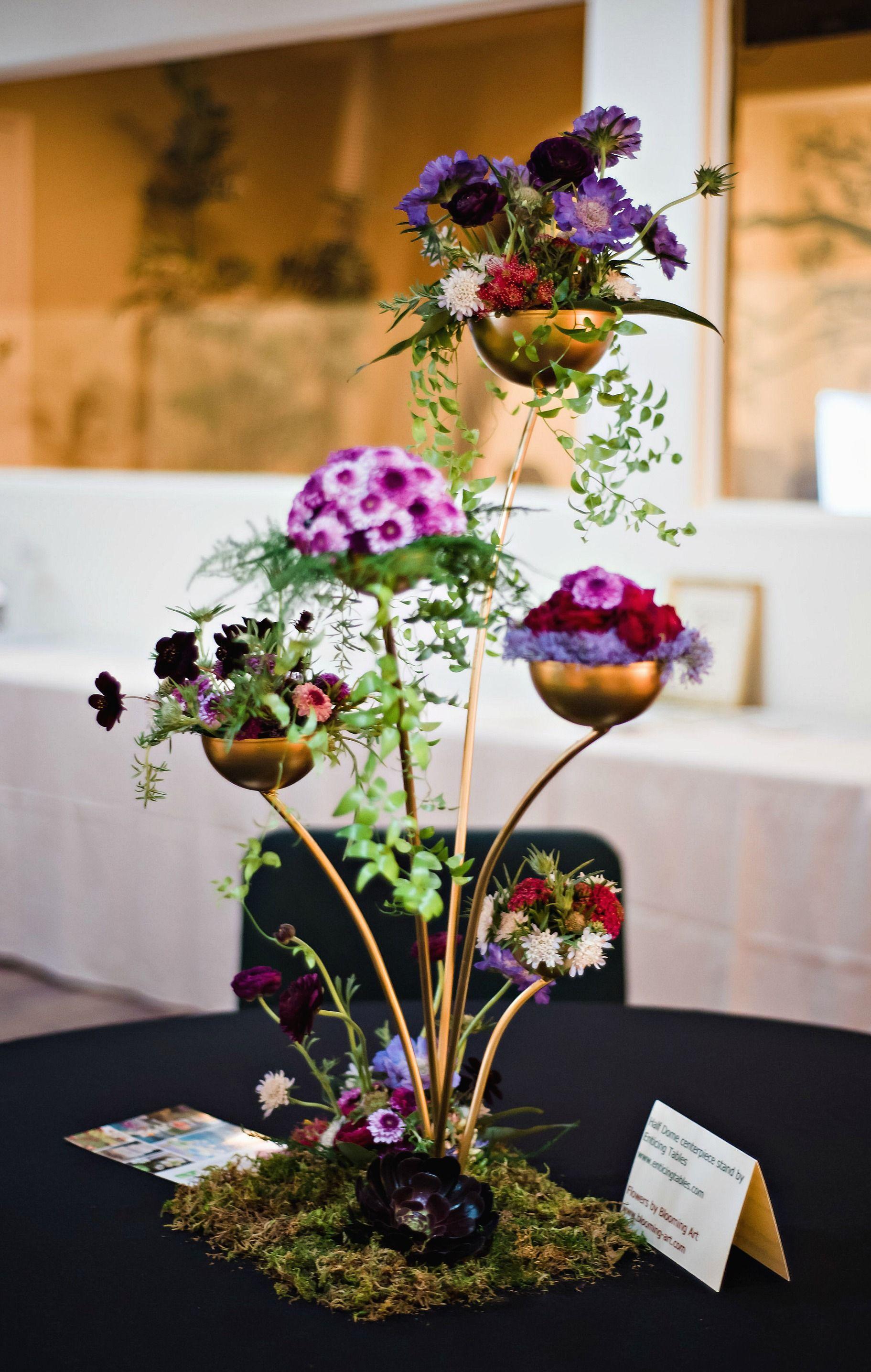 Woodland inspired flowers in shades of purple and reds in a gold woodland inspired flowers in shades of purple and reds in a gold centerpiece stand san diego izmirmasajfo
