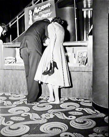 High school students selecting dance photos, 1954