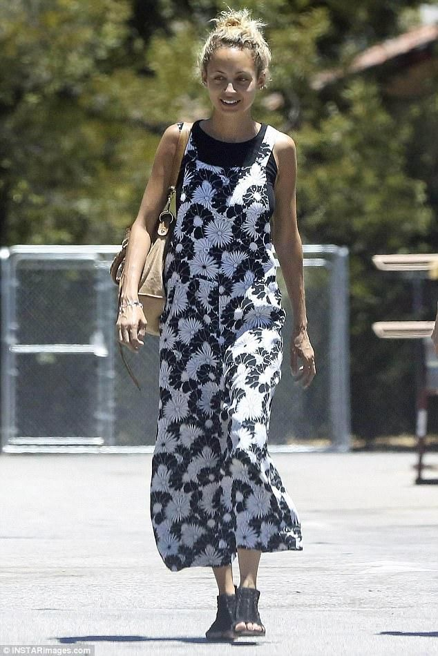 d4093b6d8dde Nicole Richie wearing Topshop Floral Jumpsuit and Balenciaga City Bag in  Tan Suede