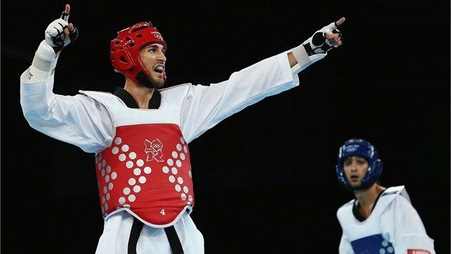 Mauro Sarmiento of Italy celebrates beating Ramin Azizov of Azerbaijan during the Men's -80kg Taekwondo quarter-final on Day 14.