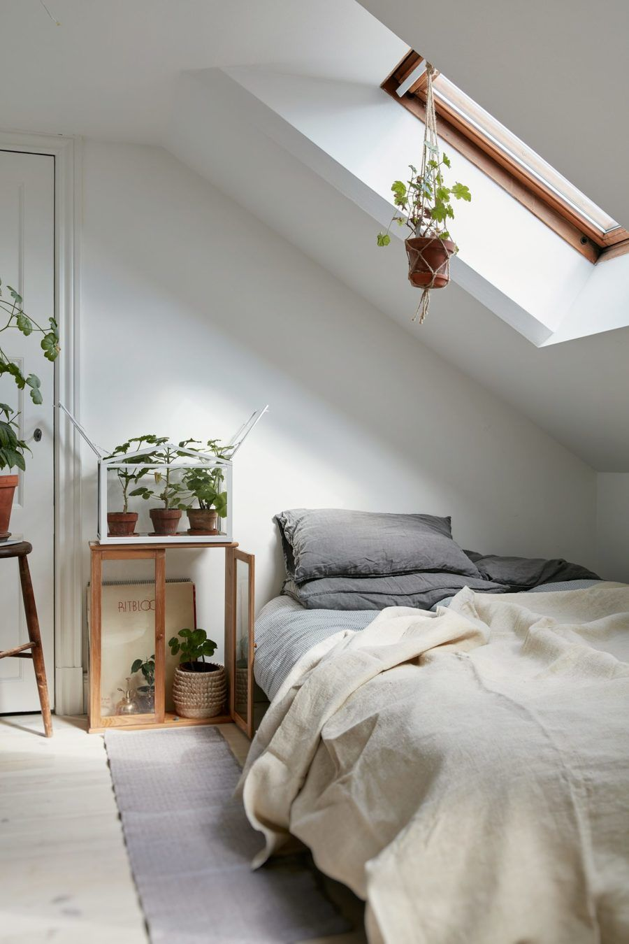 Simple And Minimal Bedroom With White Walls, Indoor Plants And Grey Accents