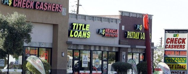 Payday loan businesses advertise their services in Phoenix on April 7, 2010. (Ross D. Franklin/AP)