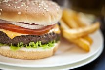 Cheeseburger with fries - GMVozd/E+/Getty Images
