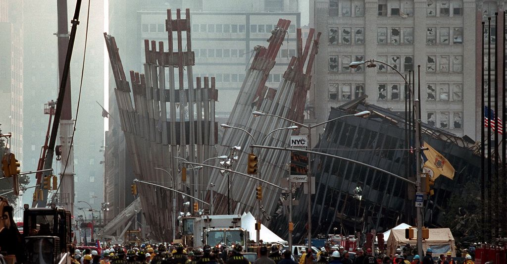 Original Caption: Remains of the World Trade Center Friday, Sept. 14, 2001 in…