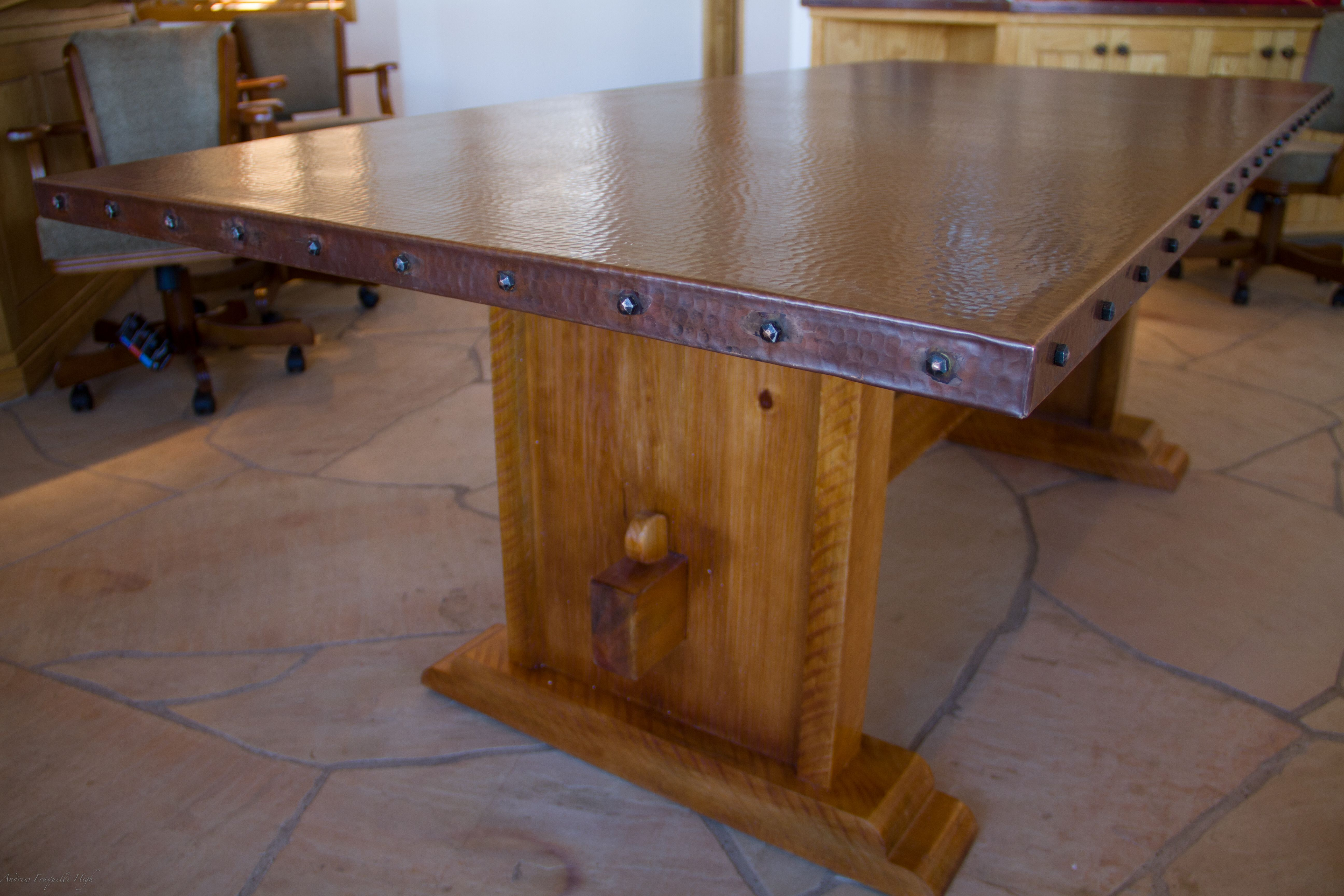 This Copper Top Table Is Tied To A Custom Rough Hewn Wood Base To Create A