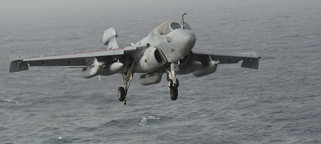 """GULF OF OMAN (July 1, 2013) – An EA-6B Prowler assigned to the """"Gray Wolves"""" of Electronic Attack Squadron (VAQ) 142 prepares to land on the flight deck of the aircraft carrier USS Nimitz (CVN 68). Nimitz Strike Group is deployed to the U.S. 5th Fleet area of responsibility conducting maritime security operations, theater security cooperation efforts and support missions for Operation Enduring Freedom. (U.S. Navy photo by Mass Communication Specialist Seaman Apprentice Kelly M. Agee…"""