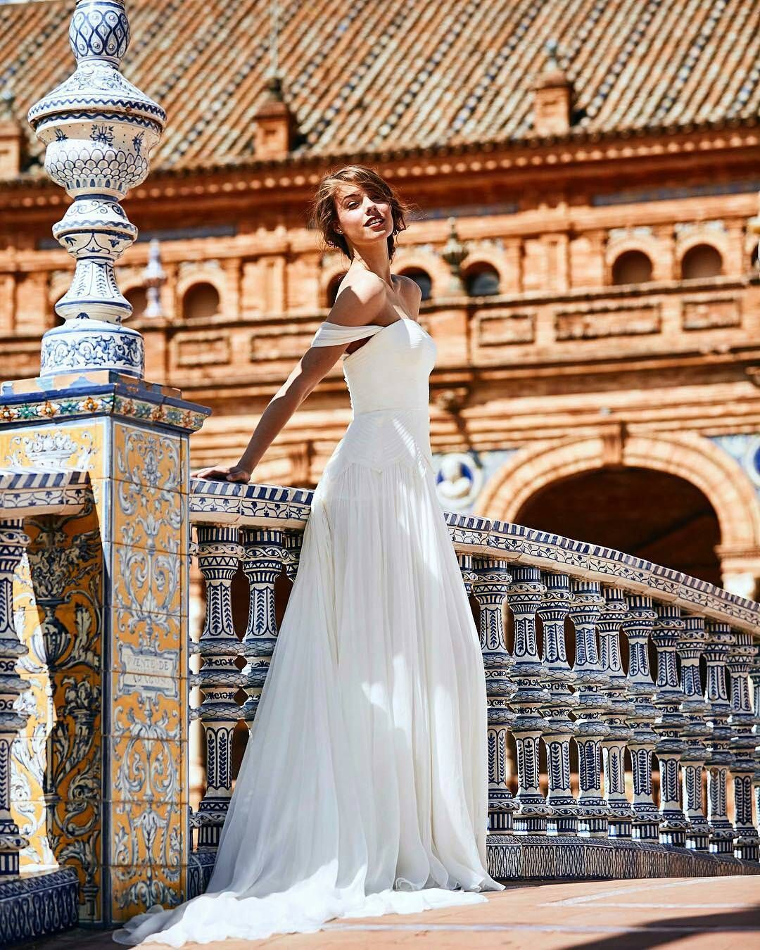Spring whites.  Bold bridal perfection in Seville's Plaza de España featuring RABAT dress by @pronovias  Photos @darioaranyo  Hair & Makeup @aranyito  http://gelinshop.com/ipost/1521779475942458125/?code=BUecl7iB8MN