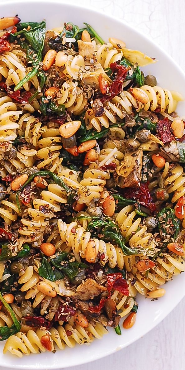 Spiral Pasta with Spinach, Artichokes, Sun-Dried Tomatoes, Capers, Garlic, and Pine Nuts