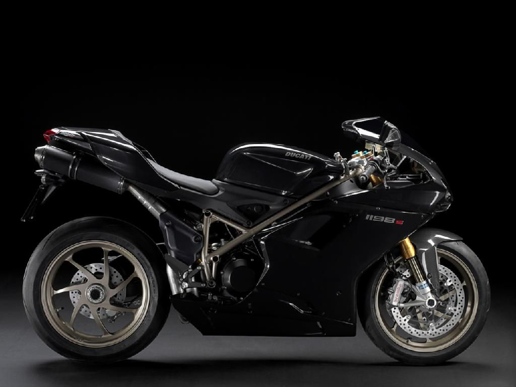 Own and learn to ride a black Ducati 1198s.