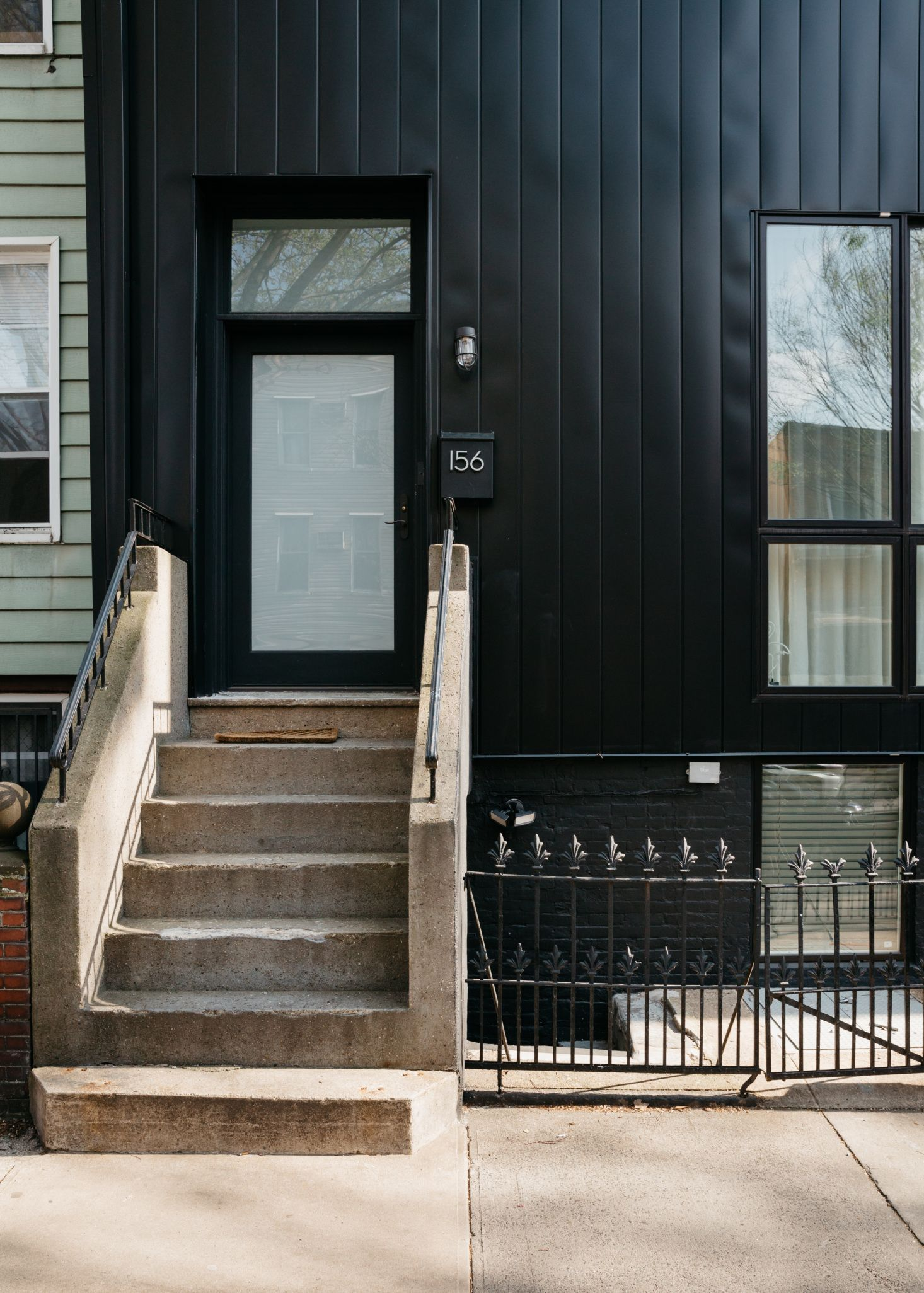 Before After A French Inflected Townhouse Renovation In Williamsburg Brooklyn Remodelista Black Exterior Doors French Doors Townhouse Exterior