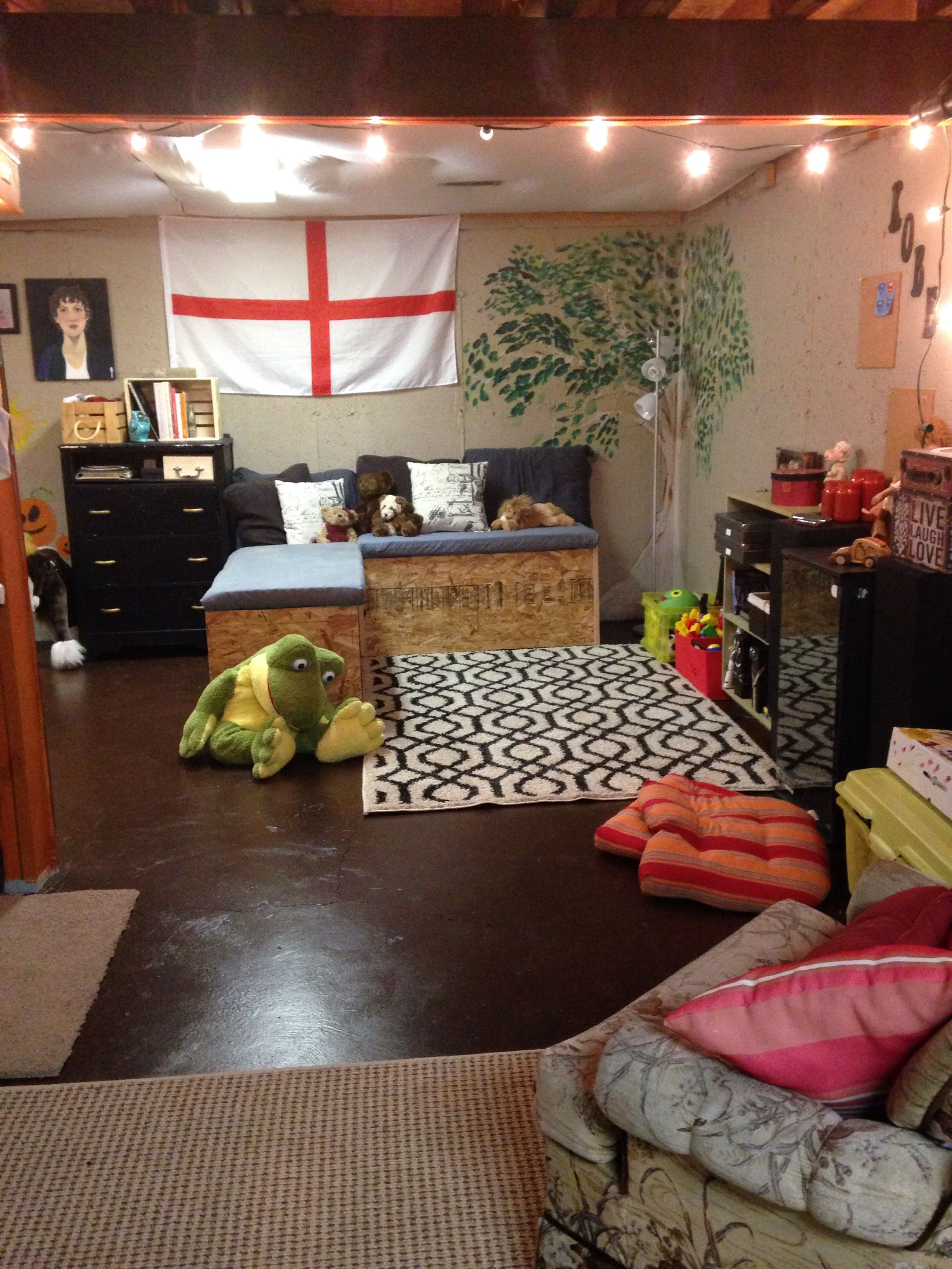 Home made storage benches & area rugs make this basement homie !