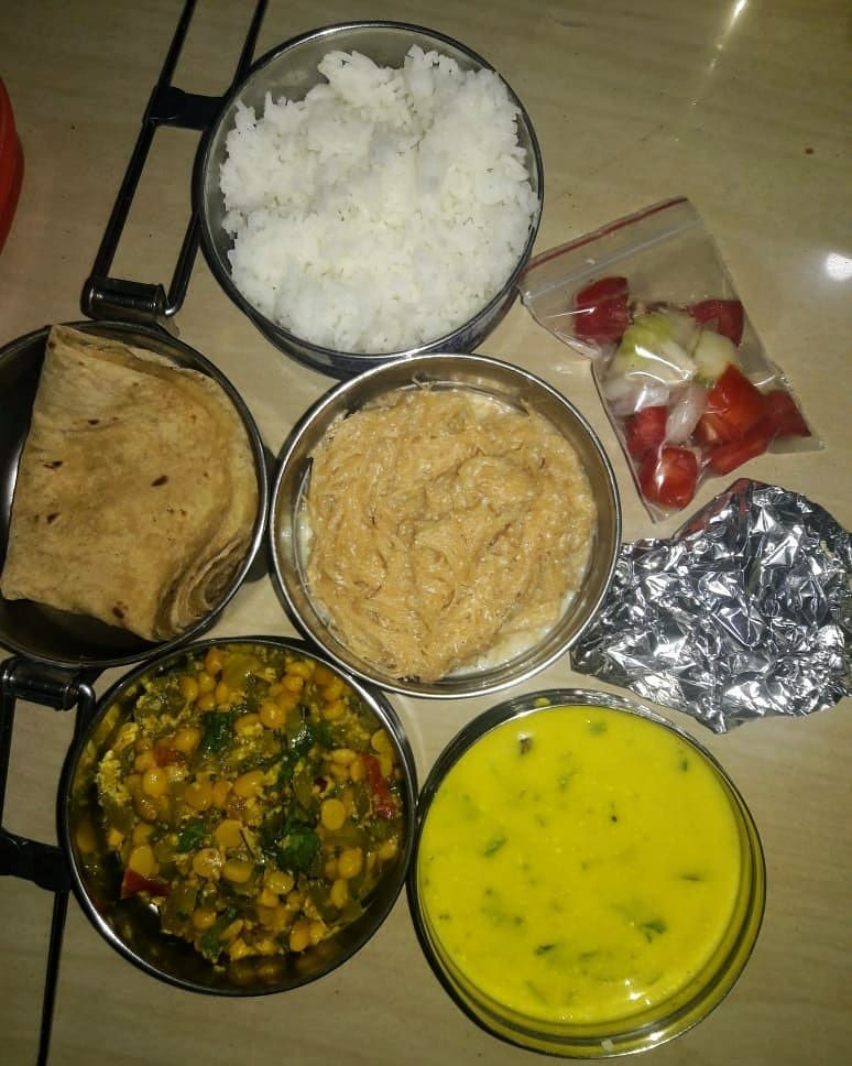 Todays tiffin !! 3 chappati, rice , kadhi,  padval saabzi, sweet and papad.  Tiffin starting rs.99  You can inbox us your contact number and we will call you back.  We also take party and various event orders.  food
