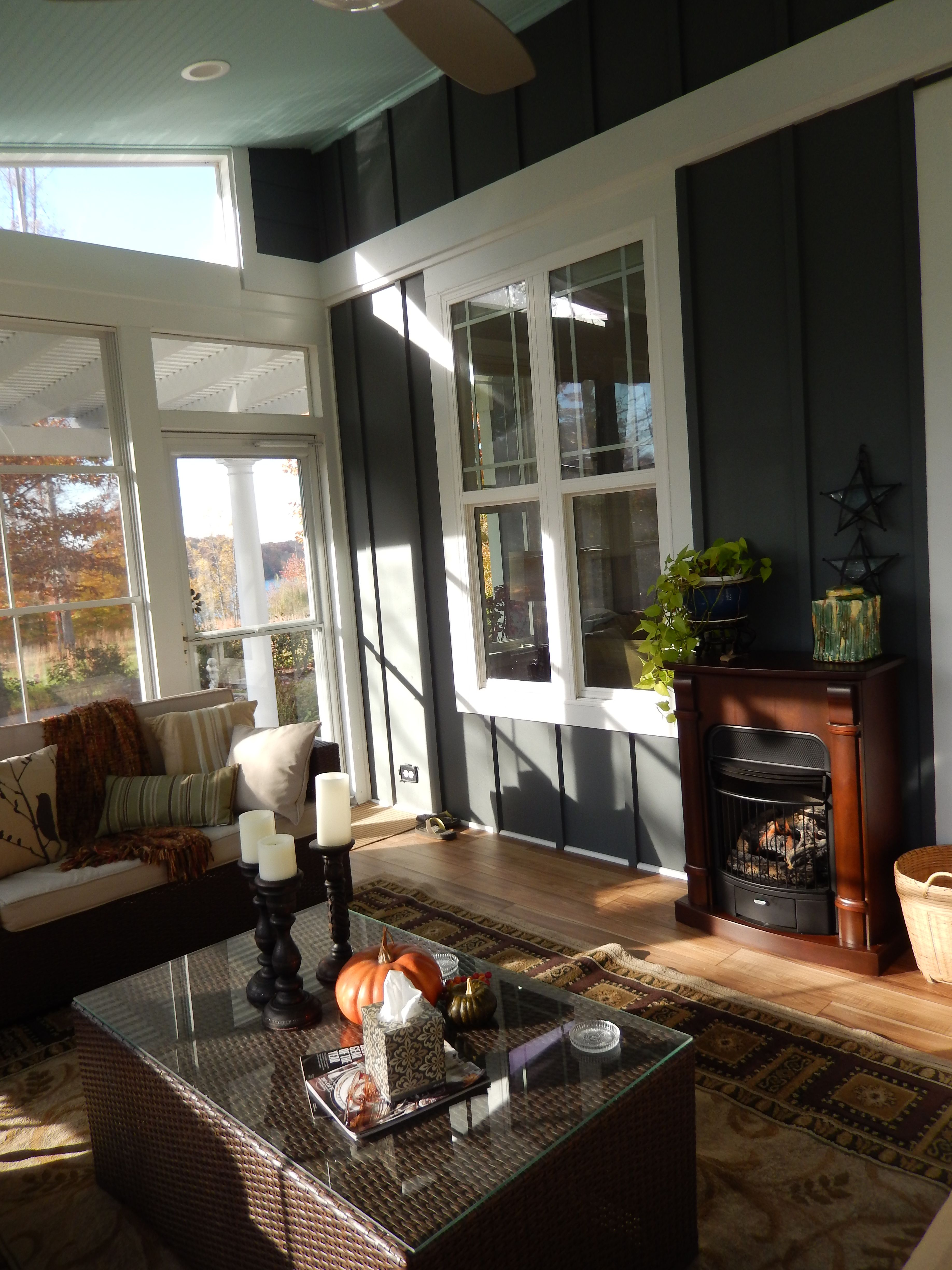 Sunroom using eze breeze windows with finished interior plus a fireplace shed roof ceiling is