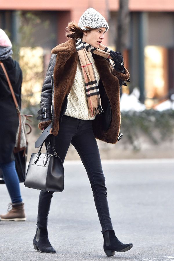 Alexa Chung - A chunky cable knit is a wardrobe mainstay. Style yours like Alexa Chung with a shearling jacket, plaid scarf and knit beanie for added warmth.