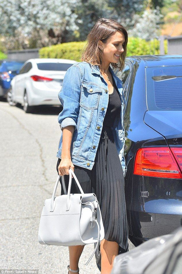 Effortless: Her white strappy wedge heels matched her white leather handbag, while she all...