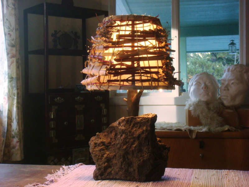 the wood rock jute and natural foliage combine to create the perfect rustic lamp