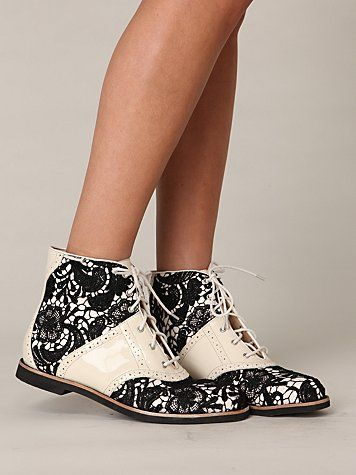 "Bass Beatrix Lace Boot €105,85 / $69.95 .... Style: 20553749 Gorgeous patent leather boot with lace fabric overlay throughout. Created by Bass Shoes in collaboration with Rachel Antonoff.   *Rachel Antonoff for Bass *Import *1"" Heel, 9"" Opening Circumference"