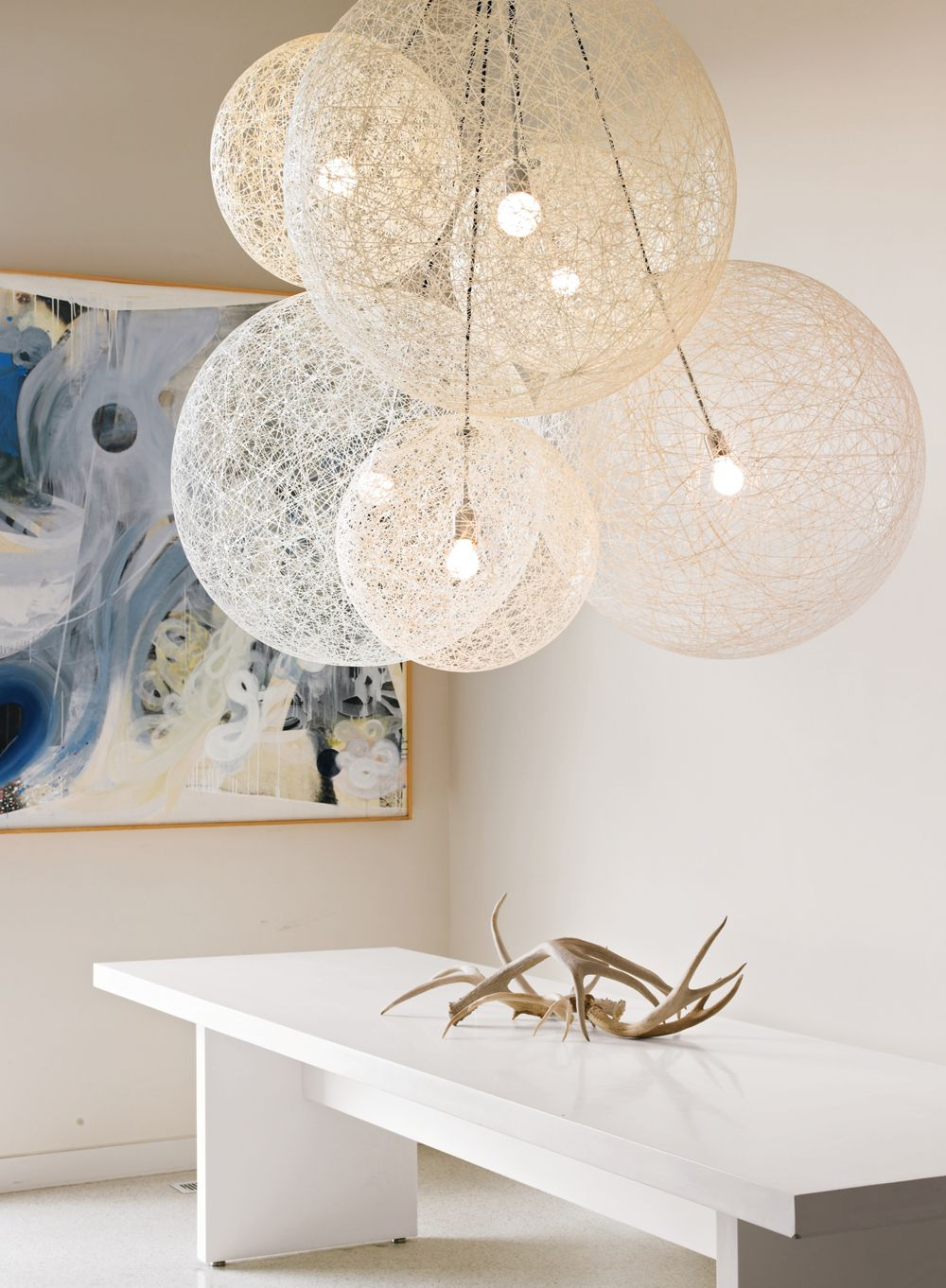 Random Light  Designed by Bertjan Pot for Moooi  Hugely dramatic, light as a feather and distinctly Dutch, the Random Light (2002) by Bertjan Pot began as a modernist craft project of sorts.  DWRDining