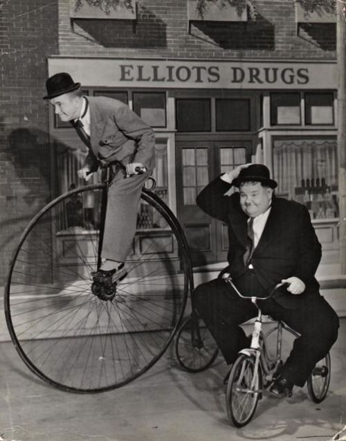 Stan Laurel And Oliver Hardy Ride Bikes Famous Bike Riders