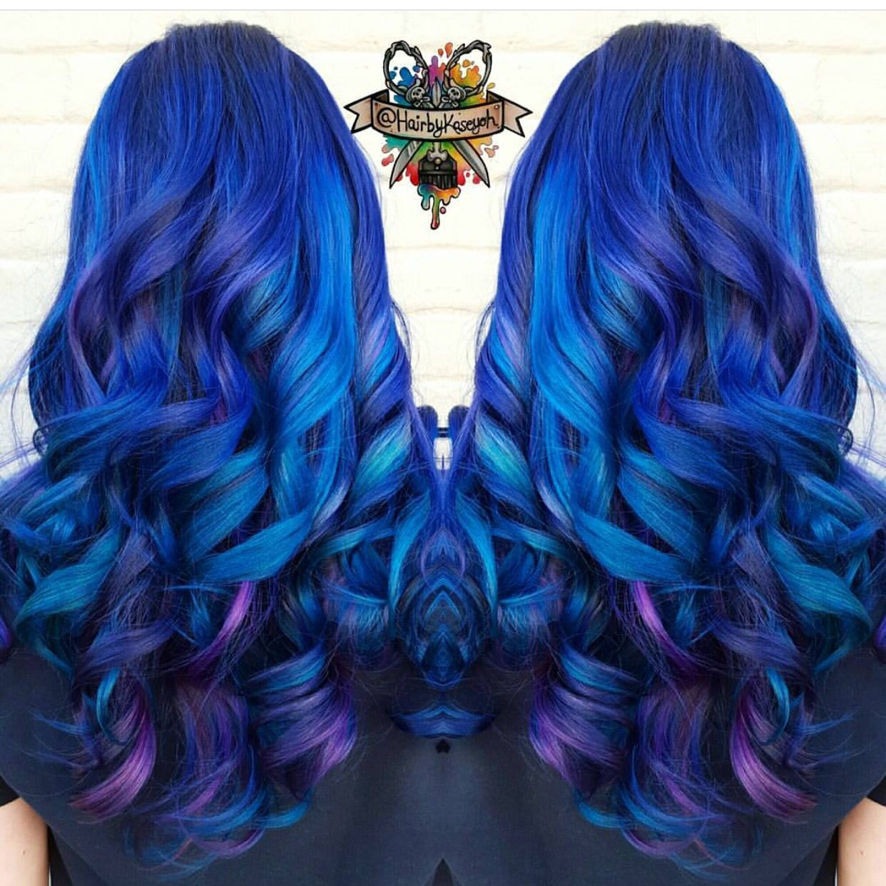 Beautiful blue and purple hair on long curly hair by hairbykoh